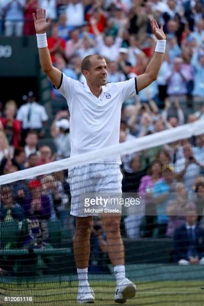 Gilles Muller of Luxembourg celebrates victory after the Gentlemen's Singles fourth round match against Rafael Nadal of Spain on day seven of the...
