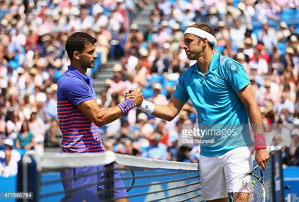 Gilles Muller of Luxembourg celebrates victory as he shakes the hand of Grigor Dimitrov of Bulgaria after their men's singles second round match...