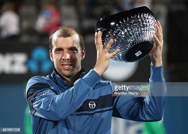Gilles Muller of Luxembourg holds aloft the winners trophy after winning the men's final match against Daniel Evans of Great Britain during the 2017...