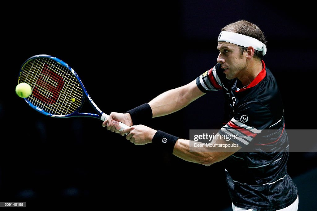 <a gi-track='captionPersonalityLinkClicked' href=/galleries/search?phrase=Gilles+Muller&family=editorial&specificpeople=224381 ng-click='$event.stopPropagation()'>Gilles Muller</a> of Luxembourg in action against Andreas Seppi of Italy during day 2 of the ABN AMRO World Tennis Tournament held at Ahoy Rotterdam on February 9, 2016 in Rotterdam, Netherlands.