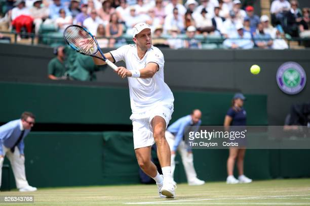 Gilles Muller of Luxembourg in action against Marin Cilic of Croatia in the Mens' Singles Quarter Final match on Court One during the Wimbledon Lawn...