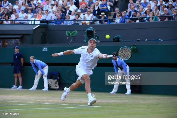 Gilles Muller of Luxembourg in action against Rafael Nadal of Spain on day seven of the 2017 Wimbledon Championships at the All England Lawn and...