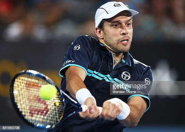 Gilles Muller of Luxembourg plays a backhand in the men's final match against Daniel Evans of Great Britain during the 2017 Sydney International at...