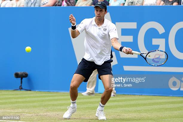 Gilles Muller of Luxembourg plays a forehand during his men's singles quarterfinal win against Alexandr Dolgopolov of Ukraine during day four of the...