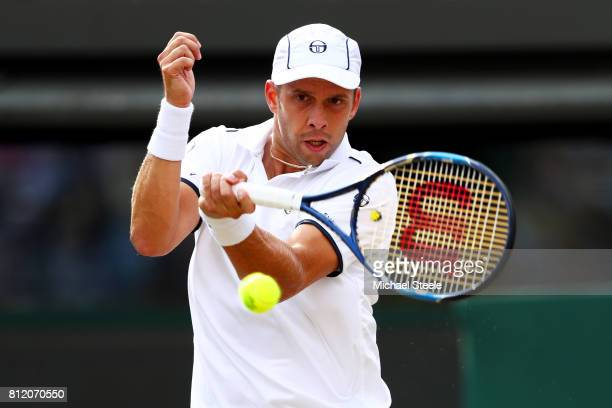 Gilles Muller of Luxembourg plays a forehand during the Gentlemen's Singles fourth round match against Rafael Nadal of Spain on day seven of the...