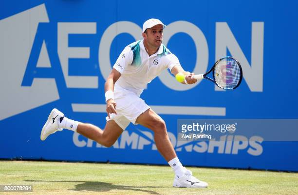 Gilles Muller of Luxembourg plays a forehand during the mens singles quarter final match against Sam Querry of The United States on day five of the...