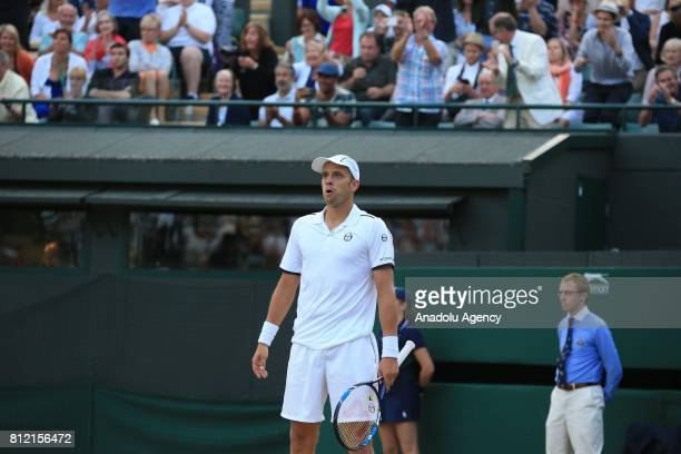 Gilles Muller of Luxembourg reacts after beating Rafael Nadal of Spain on day seven of the 2017 Wimbledon Championships at the All England Lawn and...