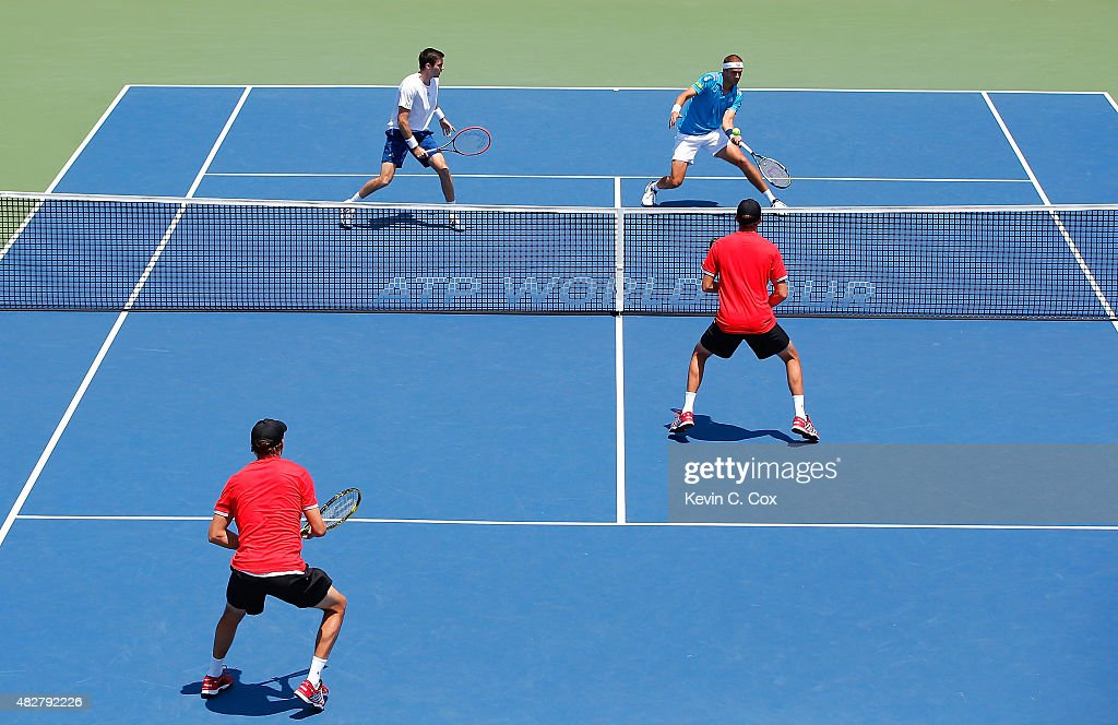 Gilles Muller of Luxembourg returns a forehand to Bob and Mike Bryan during the BB&T Atlanta Open Final at Atlantic Station on August 2, 2015 in Atlanta, Georgia.