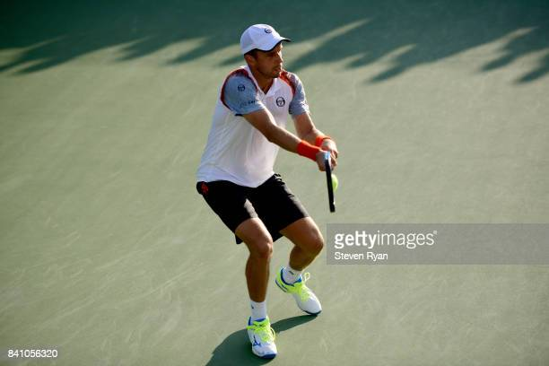 Gilles Muller of Luxembourg returns a shot against Paolo Lorenzi of Italy during their second round Men's Singles match on Day Three of the 2017 US...