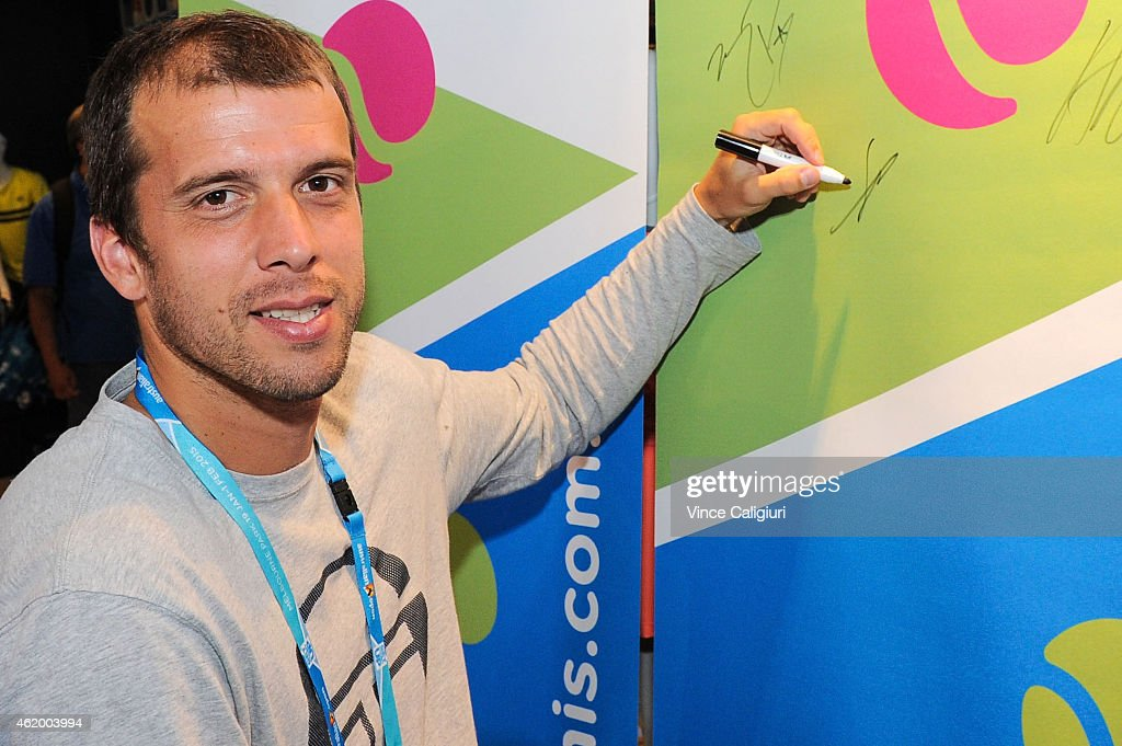 <a gi-track='captionPersonalityLinkClicked' href=/galleries/search?phrase=Gilles+Muller&family=editorial&specificpeople=224381 ng-click='$event.stopPropagation()'>Gilles Muller</a> of Luxembourg signing autographs at Autograph Island during the 2015 Australian Open at Melbourne Park on January 23, 2015 in Melbourne, Australia.