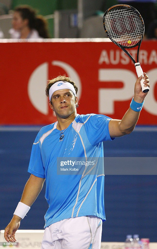 Gilles Muller of Luxembourg waves to the crowd after winning his second round match against Bernard Tomic of Australia during day three of the 2009 Australian Open at Melbourne Park on January 21, 2009 in Melbourne, Australia.