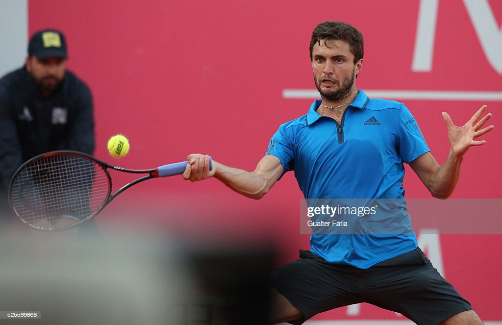Gilles Simon from France in action during the match between Gilles Simon and Paul-Henri Mathieu for Millennium Estoril Open at Clube de Tenis do Estoril on April 28, 2016 in Estoril, Portugal.