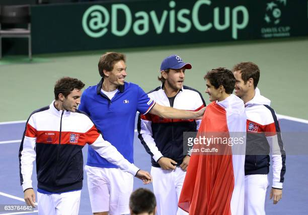 Gilles Simon Nicolas Mahut Lucas Pouille PierreHughes Herbert Richard Gasquet of France celebrate winning the doubles match and the tie 30 on day 2...
