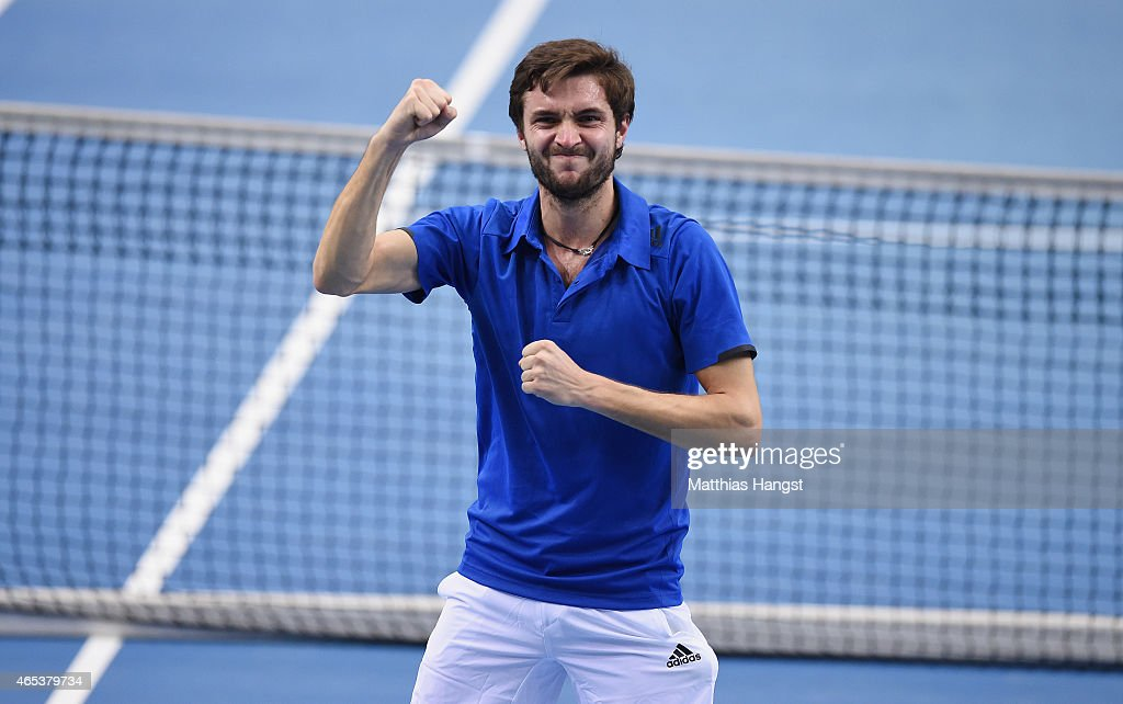 <a gi-track='captionPersonalityLinkClicked' href=/galleries/search?phrase=Gilles+Simon&family=editorial&specificpeople=548968 ng-click='$event.stopPropagation()'>Gilles Simon</a> of France celebrates after match point after his match against Jan-Lennard Struff of Germany during day one of the Davis Cup World Group first round between Germany and France at Fraport Arena on March 6, 2015 in Frankfurt am Main, Germany.