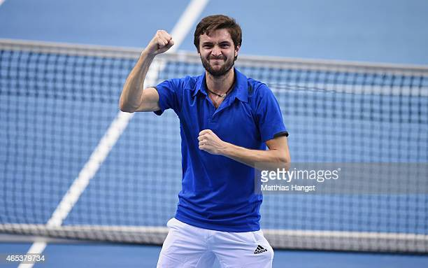 Gilles Simon of France celebrates after match point after his match against JanLennard Struff of Germany during day one of the Davis Cup World Group...