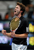 Gilles Simon of France celebrates his win in his second round match against Tomas Berdych of the Czech Republic during the ATP 500 World Tour...