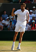 Gilles Simon of France celebrates victory in his Gentlemen's Singles Fourth Round match against Tomas Berdych of Czech Republic during day seven of...