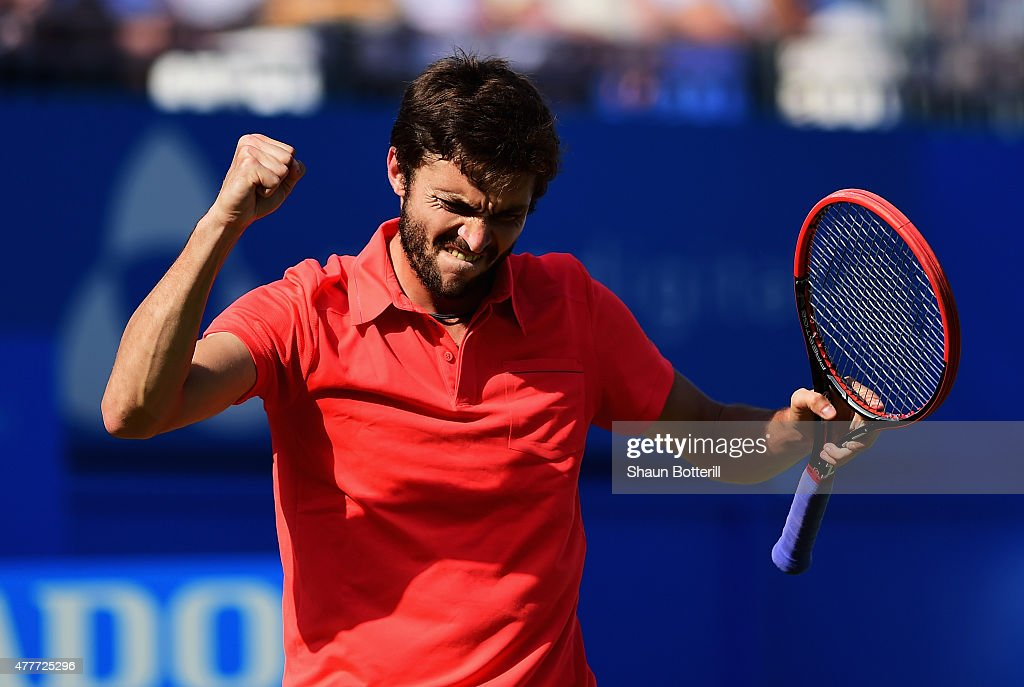 <a gi-track='captionPersonalityLinkClicked' href=/galleries/search?phrase=Gilles+Simon&family=editorial&specificpeople=548968 ng-click='$event.stopPropagation()'>Gilles Simon</a> of France celebrates victory in his men's singles quarter-final match against Milos Raonic of Canada during day five of the Aegon Championships at Queen's Club on June 19, 2015 in London, England.