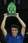 Gilles Simon of France celebrates with the trophy after the singles final match against Mischa Zverev of Germany during day seven of the Open de...