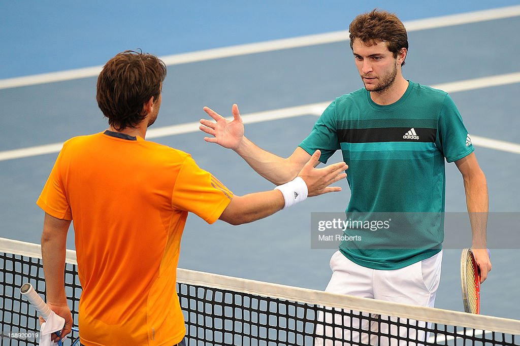 Gilles Simon of France congratulates Marcos Baghdatis of Cyrpus after their on day six of the Brisbane International at Pat Rafter Arena on January 4, 2013 in Brisbane, Australia.