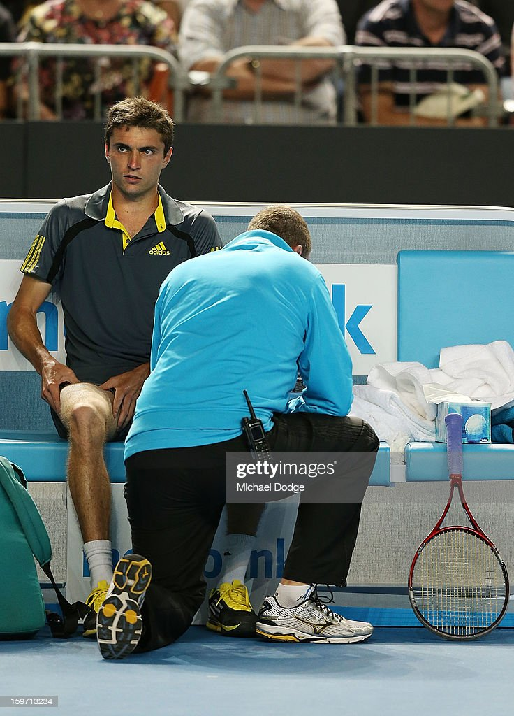Gilles Simon of France gets a medical time out in his third round match against Gael Monfils of France in the 2013 Australian Open at Melbourne Park on January 19, 2013 in Melbourne, Australia.