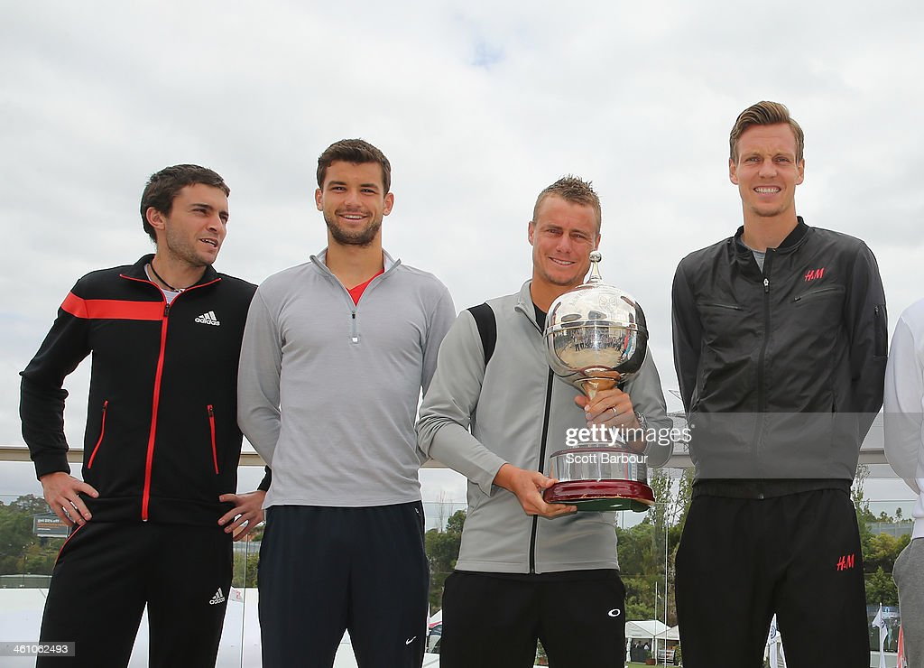 Gilles Simon of France, Grigor Dimitrov of Bulgaria, Lleyton Hewitt of Australia and Tomas Berdych of Czech Republic pose with the Kooyong Classic trophy during a press conference ahead of the AAMI Classic at Kooyong on January 7, 2014 in Melbourne, Australia.