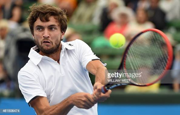 Gilles Simon of France hits a backhand return against Fernando Verdasco of Spain during their men's singles match at the Kooyong Classic tennis event...