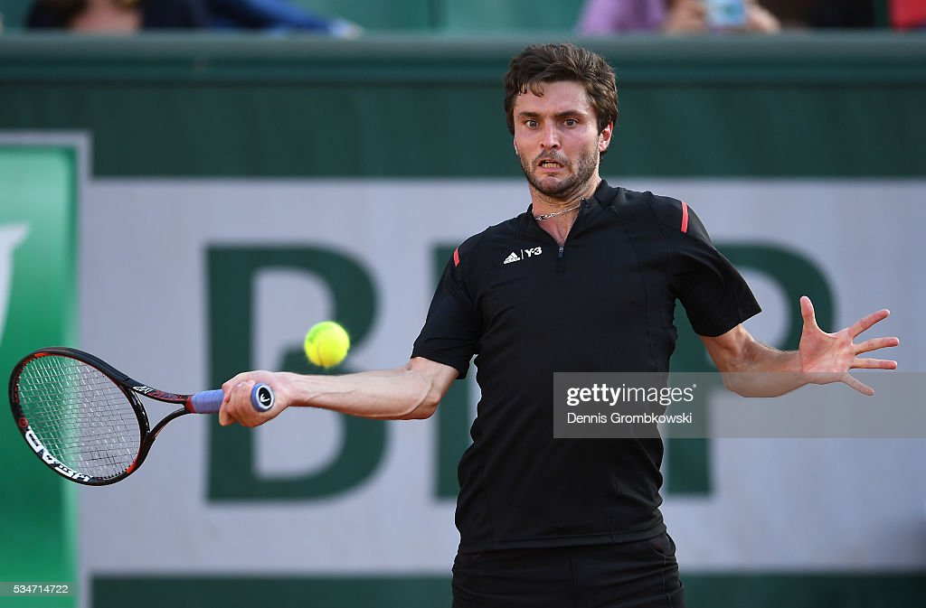 <a gi-track='captionPersonalityLinkClicked' href=/galleries/search?phrase=Gilles+Simon&family=editorial&specificpeople=548968 ng-click='$event.stopPropagation()'>Gilles Simon</a> of France hits a forehand during the Men's Singles third round match against Viktor Troicki of Serbia on day six of the 2016 French Open at Roland Garros on May 27, 2016 in Paris, France.