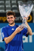 Gilles Simon of France holds the trophy after winning the Mens final against Viktor Troicki of Serbia during day seven of the 2011 Medibank...