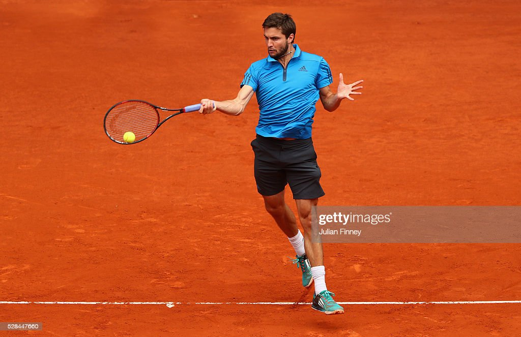 Gilles Simon of France in action against Andy Murray of Great Britain during day six of the Mutua Madrid Open tennis tournament at the Caja Magica on May 05, 2016 in Madrid, Spain.