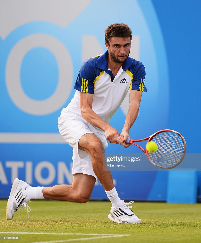 <a gi-track='captionPersonalityLinkClicked' href=/galleries/search?phrase=Gilles+Simon&family=editorial&specificpeople=548968 ng-click='$event.stopPropagation()'>Gilles Simon</a> of France in action against Kyle Edmund of Great Britain during Day Five of the AEGON International at Devonshire Park on June 19, 2013 in Eastbourne, England.