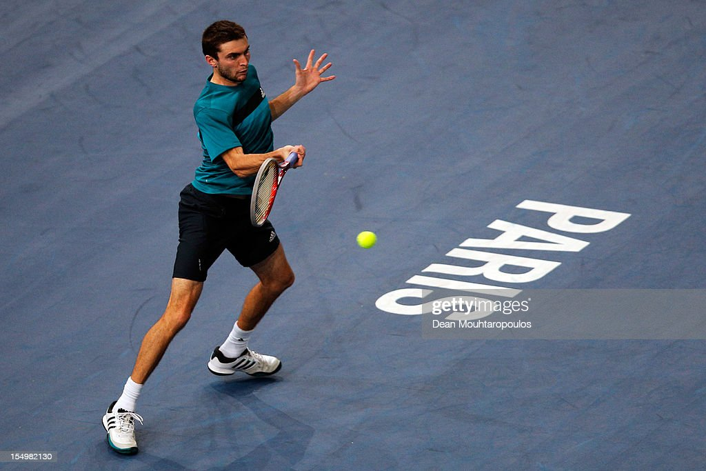 Gilles Simon of France in action against Marcos Baghdatis of Cyprus during day 1 of the BNP Paribas Masters at Palais Omnisports de Bercy on October 29, 2012 in Paris, France.