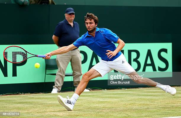 Gilles Simon of France in action during his singles match against Andy Murray of Great Britain on Day Three of The World Group Quarter Final Davis...