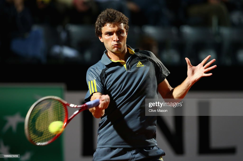 <a gi-track='captionPersonalityLinkClicked' href=/galleries/search?phrase=Gilles+Simon&family=editorial&specificpeople=548968 ng-click='$event.stopPropagation()'>Gilles Simon</a> of France in action during his third round match against Roger Federer of Switzerland on day five of the Internazionali BNL d'Italia 2013 at the Foro Italico Tennis Centre on May 16, 2013 in Rome, Italy.