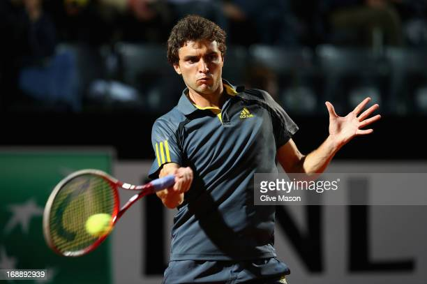 Gilles Simon of France in action during his third round match against Roger Federer of Switzerland on day five of the Internazionali BNL d'Italia...