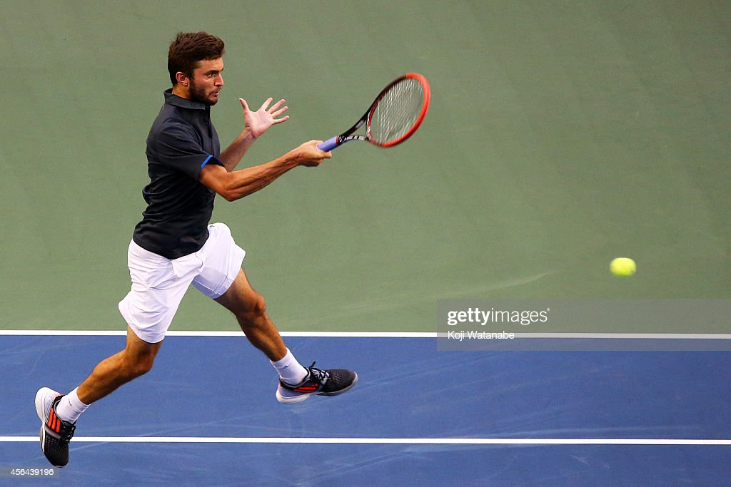 <a gi-track='captionPersonalityLinkClicked' href=/galleries/search?phrase=Gilles+Simon&family=editorial&specificpeople=548968 ng-click='$event.stopPropagation()'>Gilles Simon</a> of France in action during the men's singles second round match against Gilles Muller of Germany on day three of Rakuten Open 2014 at Ariake Colosseum on October 1, 2014 in Tokyo, Japan.