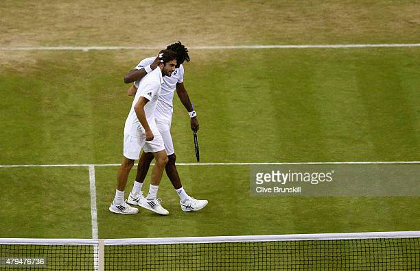 Gilles Simon of France is congratulated by Gael Monfils of France after their Mens Singles Third Round during day six of the Wimbledon Lawn Tennis...