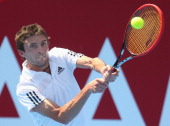 Gilles Simon of France plays a backhand during his match against Richard Gasquet of France during day three of the AAMI Classic at Kooyong on January...