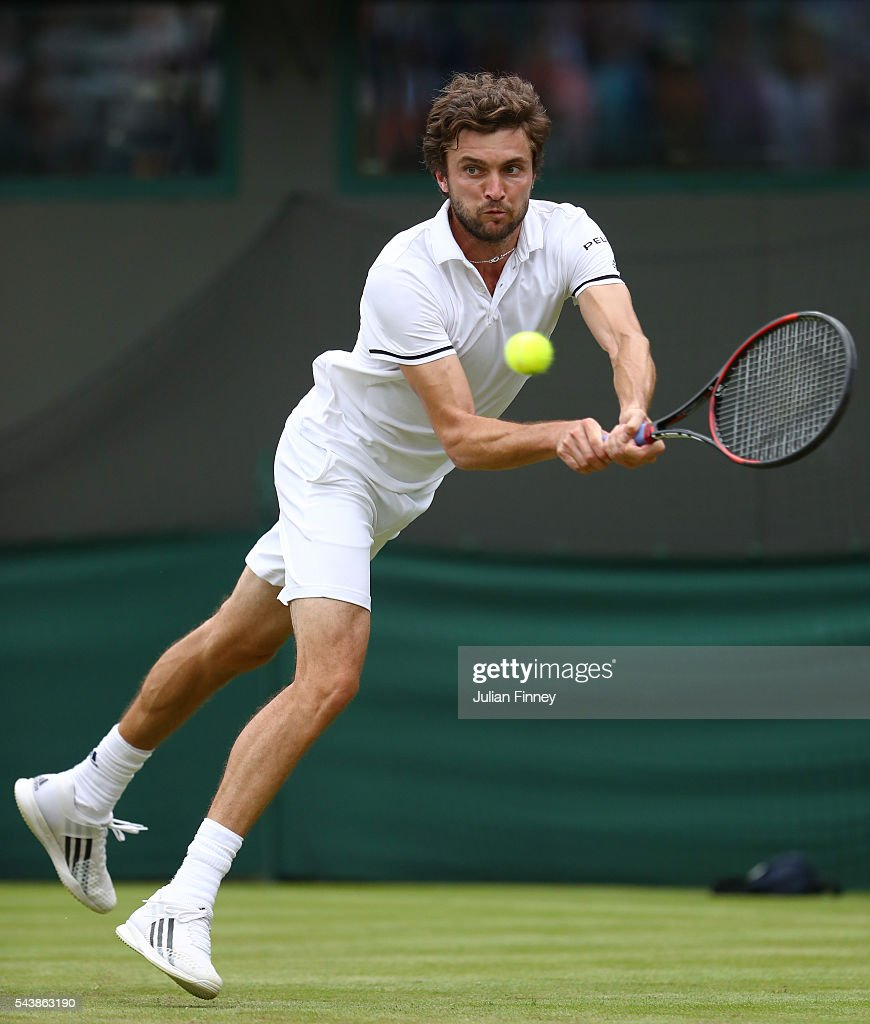 <a gi-track='captionPersonalityLinkClicked' href=/galleries/search?phrase=Gilles+Simon&family=editorial&specificpeople=548968 ng-click='$event.stopPropagation()'>Gilles Simon</a> of France plays a backhand during the Men's Singles second round match against Grigor Dimitrov of Bulgaria on day four of the Wimbledon Lawn Tennis Championships at the All England Lawn Tennis and Croquet Club on June 30, 2016 in London, England.