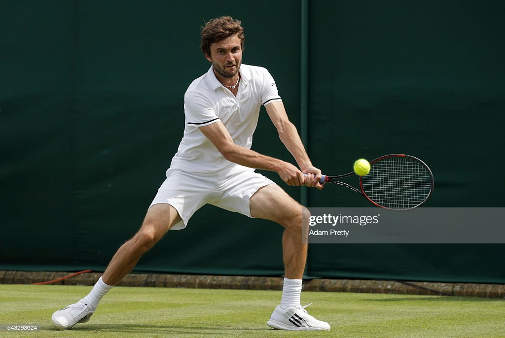 <a gi-track='captionPersonalityLinkClicked' href=/galleries/search?phrase=Gilles+Simon&family=editorial&specificpeople=548968 ng-click='$event.stopPropagation()'>Gilles Simon</a> of France plays a backhand shot during the Men's Singles first round against Janko Tipsarevic of Serbia on day one of the Wimbledon Lawn Tennis Championships at the All England Lawn Tennis and Croquet Club on June 27th, 2016 in London, England.
