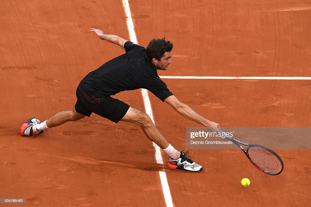 Gilles Simon of France plays a forehand during the Men's Singles second round match against Guido Pella of Argentina on day four of the 2016 French Open at Roland Garros on May 25, 2016 in Paris, France.