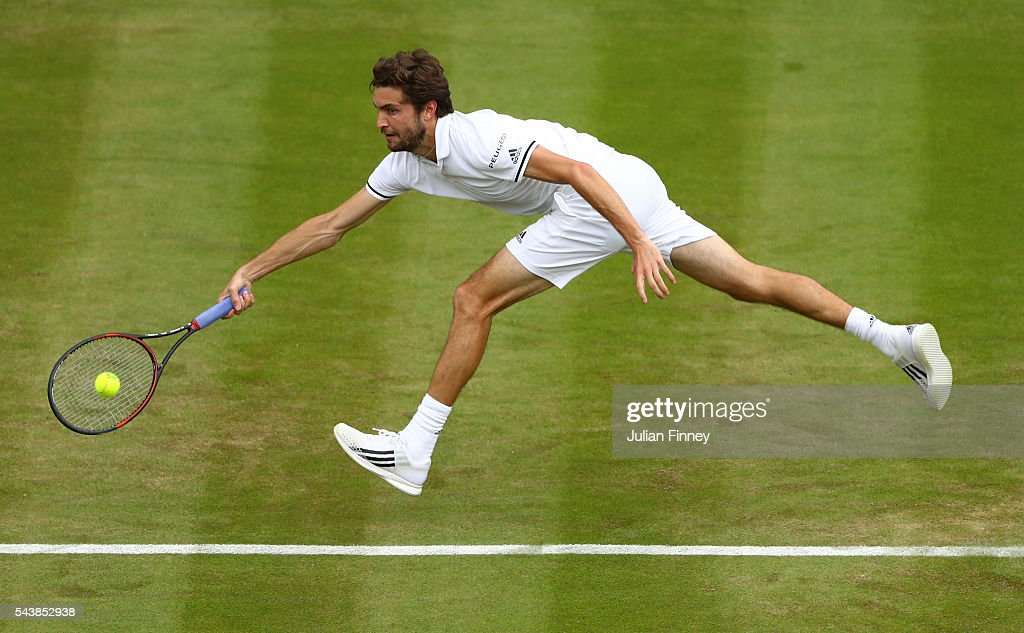 <a gi-track='captionPersonalityLinkClicked' href=/galleries/search?phrase=Gilles+Simon&family=editorial&specificpeople=548968 ng-click='$event.stopPropagation()'>Gilles Simon</a> of France plays a forehand during the Men's Singles second round match against Grigor Dimitrov of Bulgaria on day four of the Wimbledon Lawn Tennis Championships at the All England Lawn Tennis and Croquet Club on June 30, 2016 in London, England.
