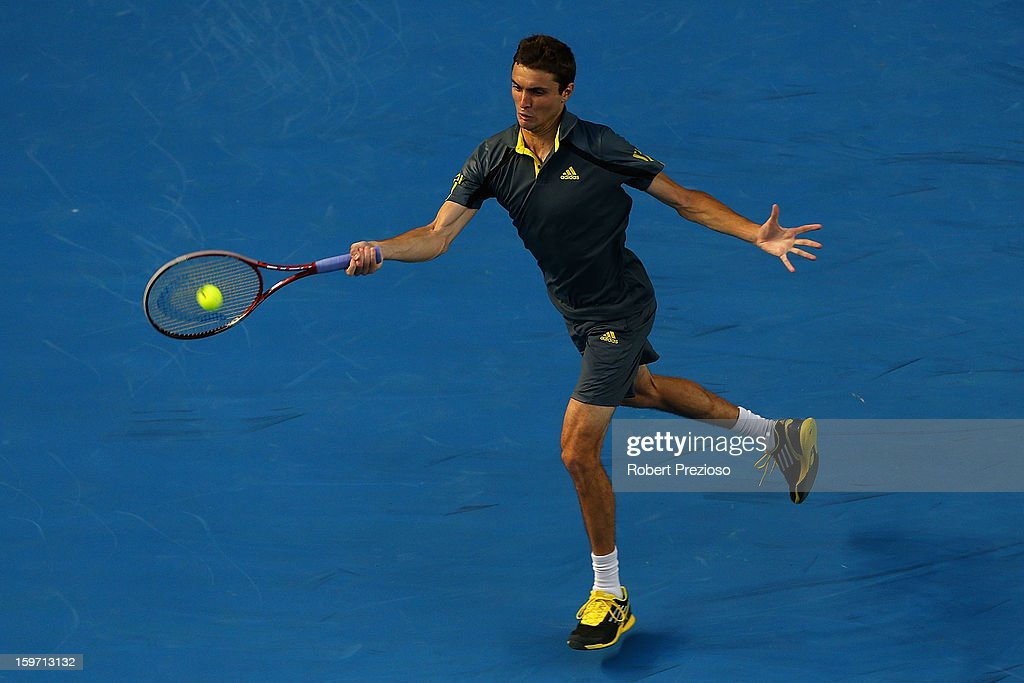 Gilles Simon of France plays a forehand in his third round match against Gael Monfils of France during day six of the 2013 Australian Open at Melbourne Park on January 19, 2013 in Melbourne, Australia.