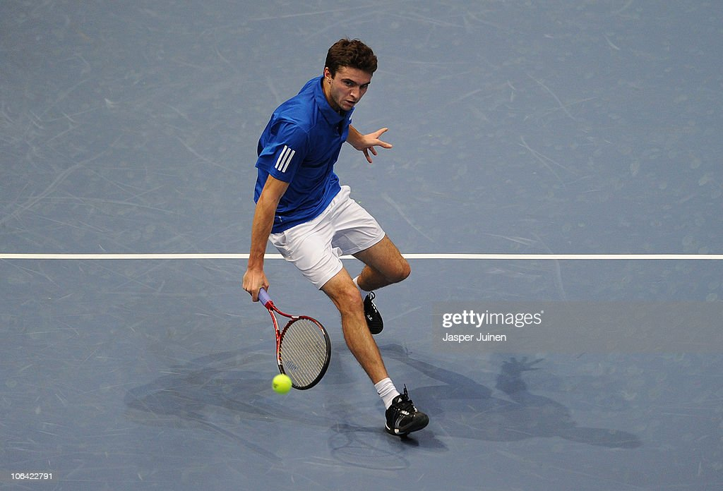 Gilles Simon of France plays a forehand to Sergiy Stakhovsky of Ukraine in his first round match during the ATP 500 World Tour Valencia Open tennis tournament at the Ciudad de las Artes y las Ciencias on November 1, 2010 in Valencia, Spain.