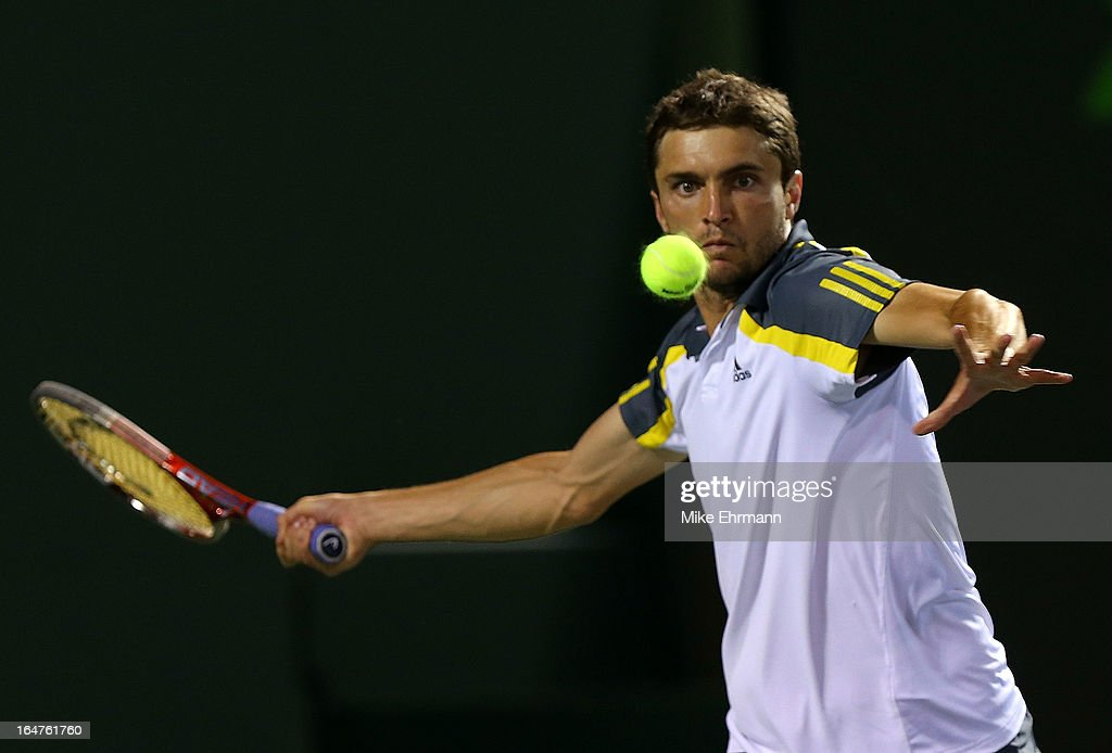 Gilles Simon of France plays a match against Tommy Haas of Germany during Day 10 of the Sony Open at Crandon Park Tennis Center on March 27, 2013 in Key Biscayne, Florida.