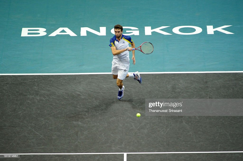 <a gi-track='captionPersonalityLinkClicked' href=/galleries/search?phrase=Gilles+Simon&family=editorial&specificpeople=548968 ng-click='$event.stopPropagation()'>Gilles Simon</a> of France plays a shot in his match against Bernard Tomic of Australian during the 2013 Thailand Open at Impact Arena on September 26, 2013 in Bangkok, Thailand.
