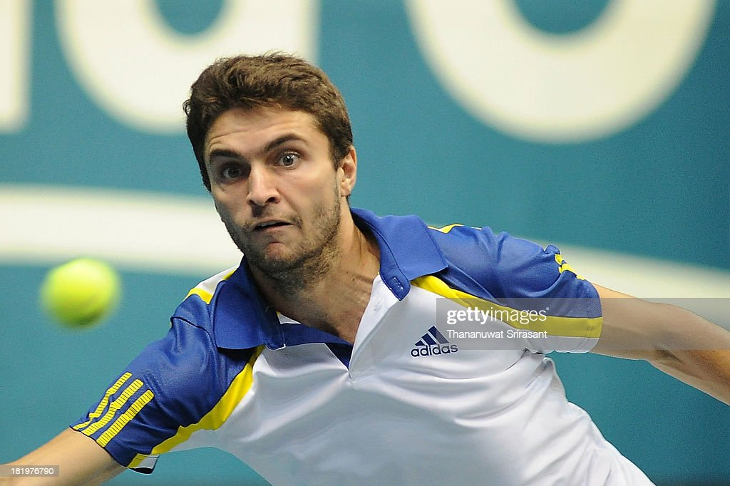 Gilles Simon of France plays a shot in his match against Bernard Tomic of Australian during the 2013 Thailand Open at Impact Arena on September 26, 2013 in Bangkok, Thailand.