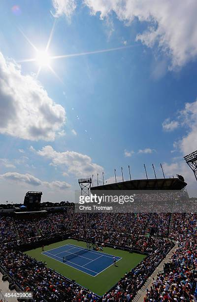 Gilles Simon of France plays against David Ferrer of Spain during their men's singles third round match on Day Seven of the 2014 US Open at the USTA...