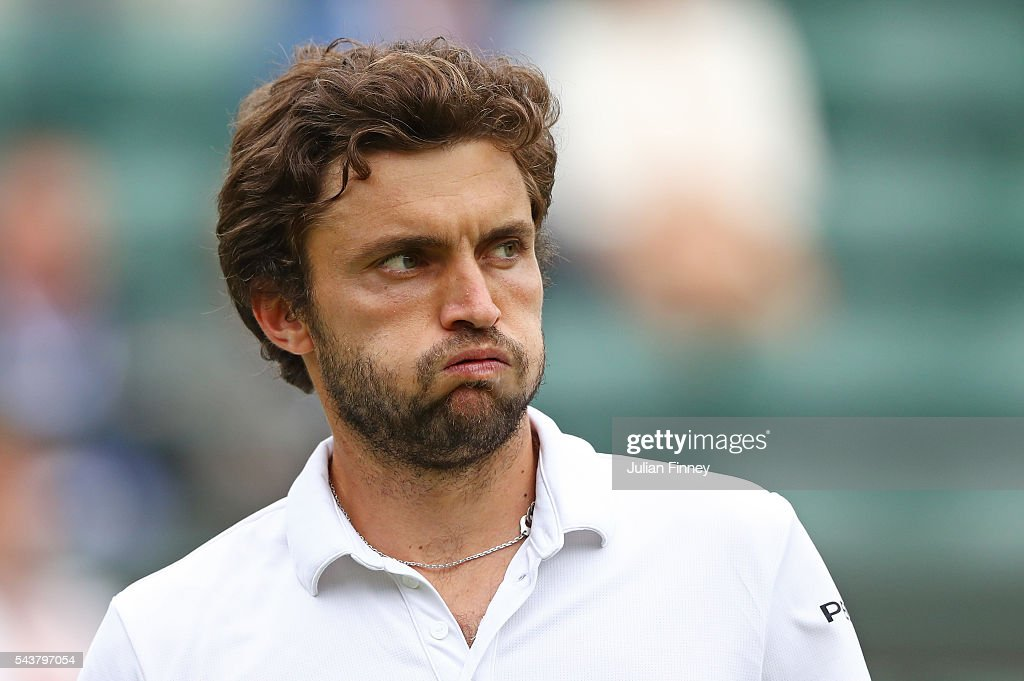 <a gi-track='captionPersonalityLinkClicked' href=/galleries/search?phrase=Gilles+Simon&family=editorial&specificpeople=548968 ng-click='$event.stopPropagation()'>Gilles Simon</a> of France plays looks on during the Men's Singles second round match against Grigor Dimitrov of Bulgaria on day four of the Wimbledon Lawn Tennis Championships at the All England Lawn Tennis and Croquet Club on June 30, 2016 in London, England.