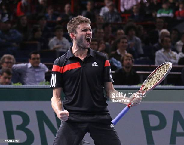 Gilles Simon of France reacts after winning his second round match against Nicolas Mahut of France during the BNP Paribas Masters at Palais...